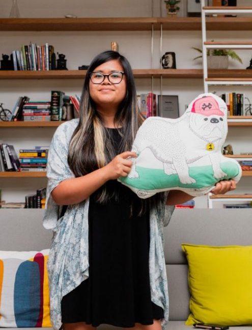 Alyssa holding a dog pillow
